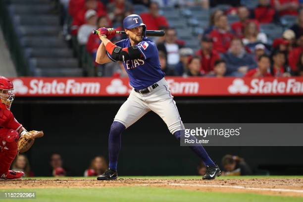 Hunter Pence of the Texas Rangers bats during the game against the Los Angeles Angels at Angel Stadium on May 25 2019 in Anaheim California The...