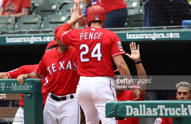 Hunter Pence of the Texas Rangers celebrates a run against the Seattle Mariners in the first inning at Globe Life Park in Arlington on May 22 2019 in...