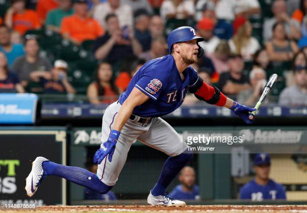 Hunter Pence of the Texas Rangers flies out in the seventh inning against the Houston Astros at Minute Maid Park on May 10 2019 in Houston Texas