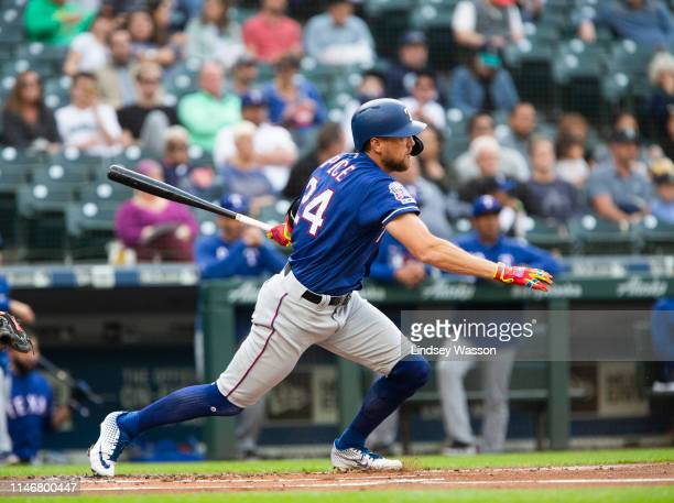Hunter Pence of the Texas Rangers follows through on a single in the first inning against the Seattle Mariners at TMobile Park on May 28 2019 in...