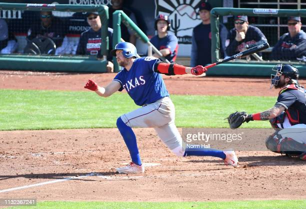 Hunter Pence of the Texas Rangers follows through on a swing during a spring training game against the Cleveland Indians at Goodyear Ballpark on...