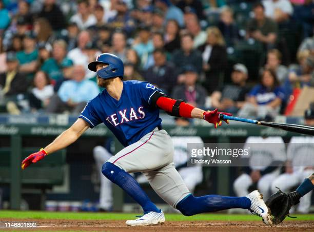 Hunter Pence of the Texas Rangers follows through on a tworun double in the fifth inning against the Seattle Mariners at TMobile Park on May 28 2019...