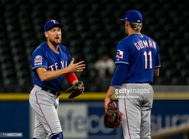 Hunter Pence of the Texas Rangers greets Ronald Guzman after a win against the Seattle Mariners at TMobile Park on May 28 2019 in Seattle Washington...