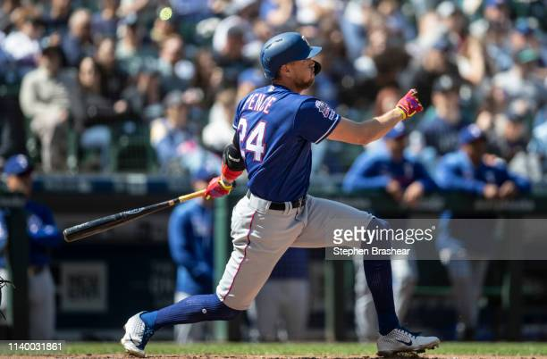 Hunter Pence of the Texas Rangers hits a onerun double off of starting pitcher Erik Swanson of the Seattle Mariners that scored Elvis Andrus of the...