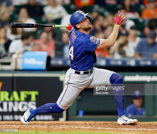 Hunter Pence of the Texas Rangers hits a tworun home run in the fourth inning against the Houston Astros at Minute Maid Park on May 09 2019 in...