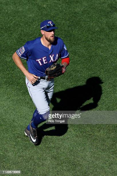 Hunter Pence of the Texas Rangers jogs to the dugout during the game between the Texas Rangers and the Boston Red Sox at Fenway Park on Wednesday...