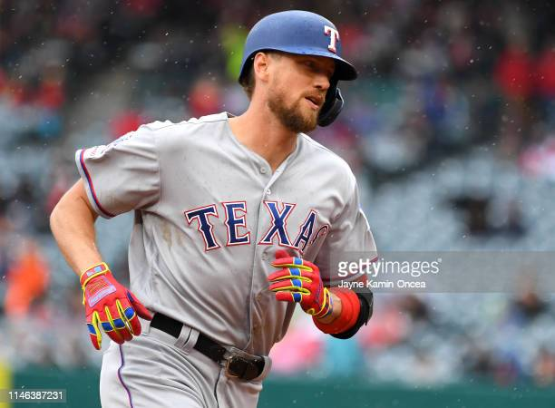 Hunter Pence of the Texas Rangers rounds the bases after hitting a solo home run in the fourth inning of the game against the Los Angeles Angels of...