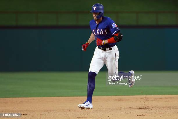 Hunter Pence of the Texas Rangers rounds the bases after hitting a tworun home run against the Seattle Mariners in the bottom of the seventh inning...