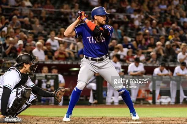 Hunter Pence of the Texas Rangers stands at bat in the ninth inning of the MLB game against the Arizona Diamondbacks at Chase Field on April 09 2019...