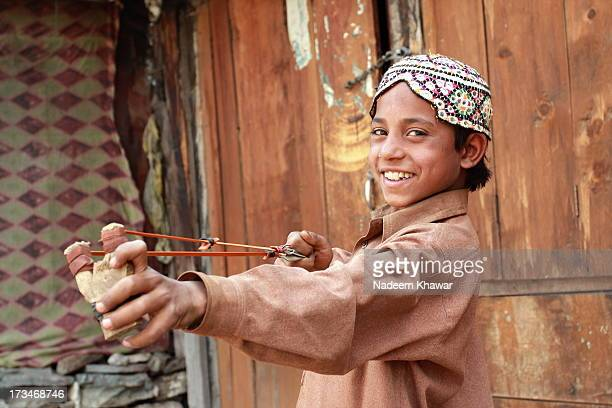 hunter - pakistani boys stock photos and pictures