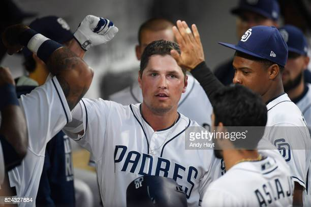 Hunter Renfroe is congratulated by teammates of the San Diego Padres after hitting a home run during the game against the New York Mets at PETCO Park...