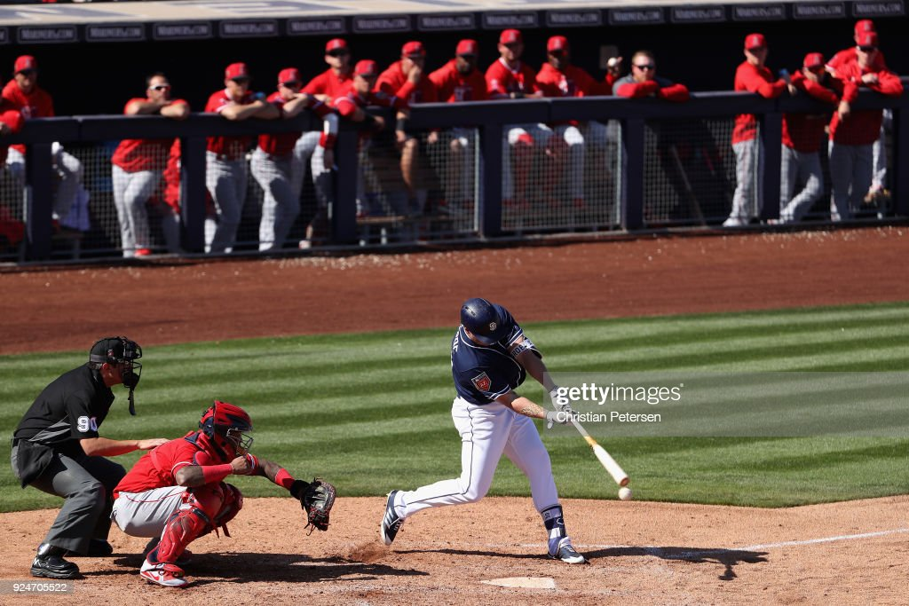 Hunter Renfroe #10 of the San Diego Padres bats against the Los Angeles Angels during the third inning of the spring training game at Peoria Stadium on February 26, 2018 in Peoria, Arizona.