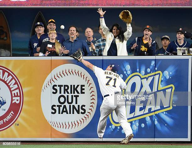 Hunter Renfroe of the San Diego Padres can't make the catch on a double off the bat of Joe Panik of the San Francisco Giants during the eighth inning...