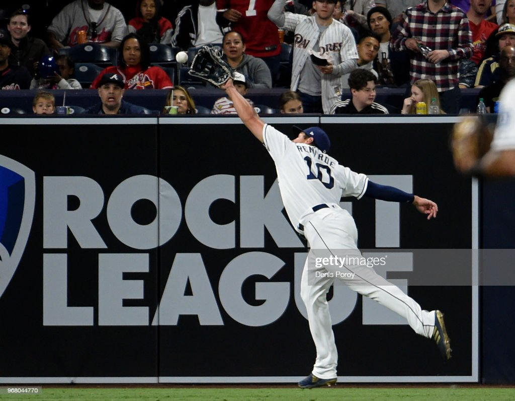 Hunter Renfroe #10 of the San Diego Padres can't make the catch on an RBI double hit by Ryan Flaherty #27 of the Atlanta Braves during the seventh inning of a baseball game at PETCO Park on June 5, 2018 in San Diego, California.