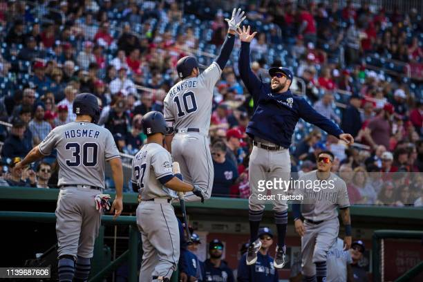 Hunter Renfroe of the San Diego Padres celebrates with teammates after hitting a home run against the Washington Nationals during the second inning...
