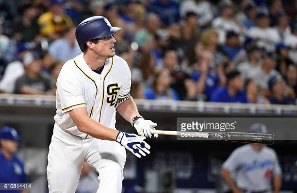 Hunter Renfroe of the San Diego Padres hits a grand slam during the eighth inning of a baseball game against the Los Angeles Dodgers at PETCO Park on...