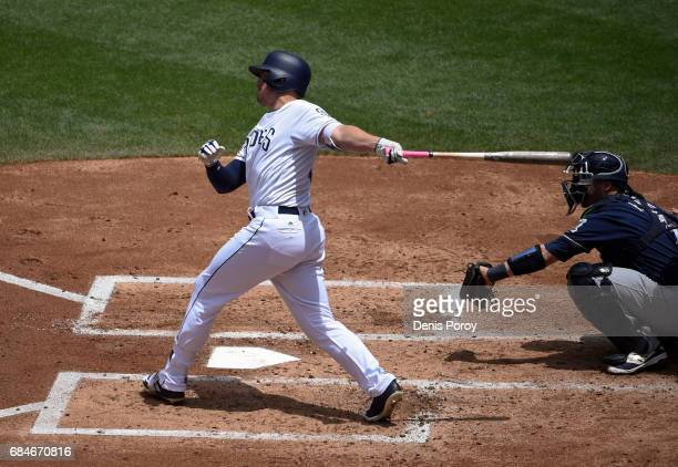 Hunter Renfroe of the San Diego Padres hits a solo home run during the second inning of a baseball game against the Milwaukee Brewers at PETCO Park...