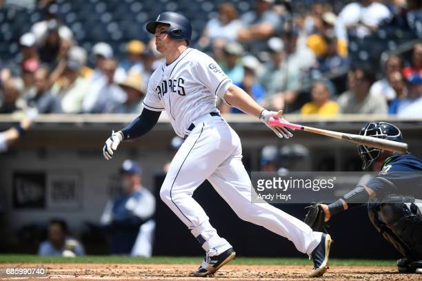 Hunter Renfroe of the San Diego Padres hits a solo home run during the game against the Milwaukee Brewers at Petco Park on May 18 2017 in San Diego...