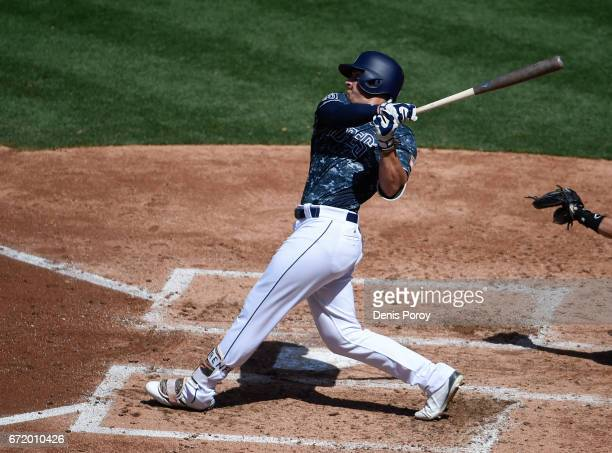 Hunter Renfroe of the San Diego Padres hits a tworun home run during the fourth inning of a baseball game against the Miami Marlins at PETCO Park on...