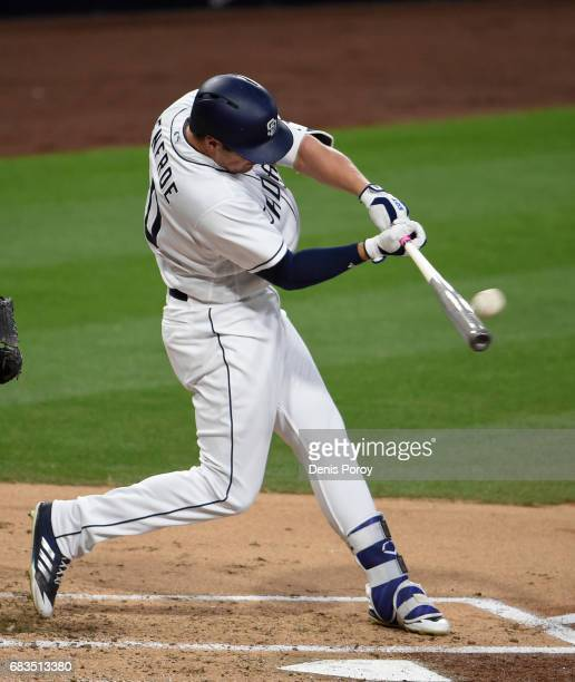 Hunter Renfroe of the San Diego Padres hits an RBI double during the second inning of a baseball game against the Milwaukee Brewers at PETCO Park on...