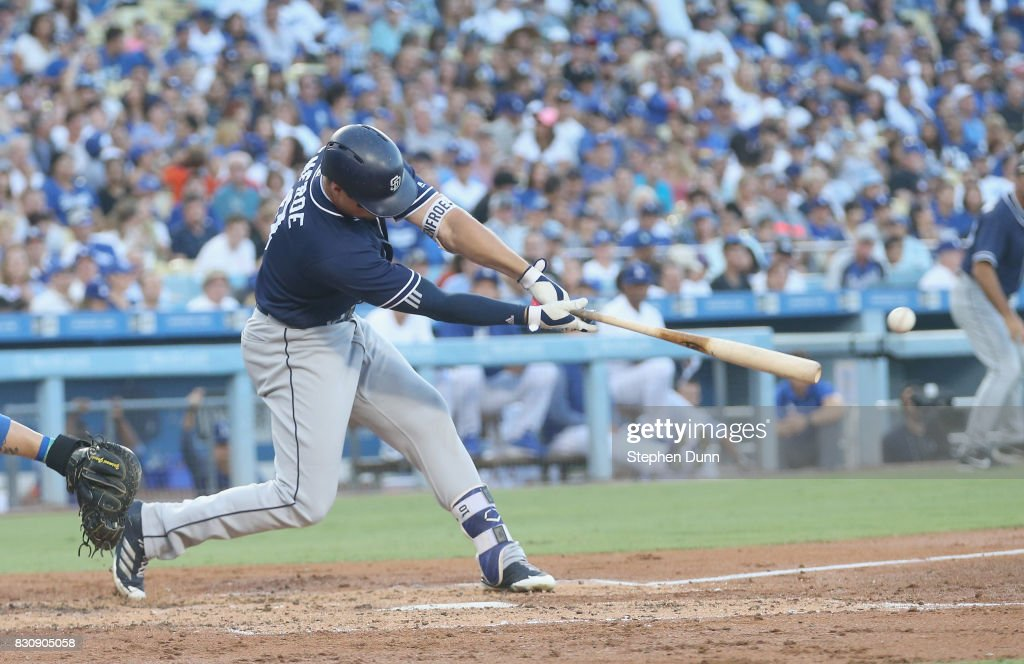 Hunter Renfroe #10 of the San Diego Padres hits an RBI double in the third inning against the Los Angeles Dodgers at Dodger Stadium on August 12, 2017 in Los Angeles, California.