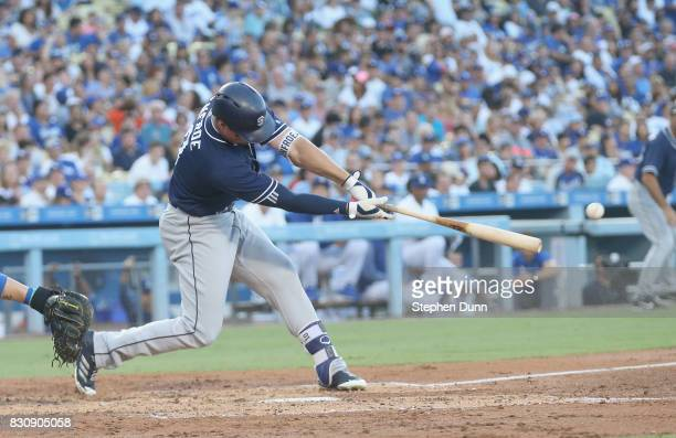 Hunter Renfroe of the San Diego Padres hits an RBI double in the third inning against the Los Angeles Dodgers at Dodger Stadium on August 12 2017 in...