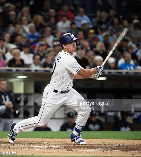 Hunter Renfroe of the San Diego Padres hits an RBI triple during the fourth inning of a baseball game against the Atlanta Braves at PETCO Park on...