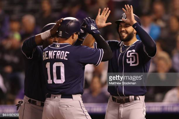 Hunter Renfroe of the San Diego Padres is congratulated at the plate by Manuel Margot and Eric Hosmer after hitting a 3 RBI home run in the seventh...