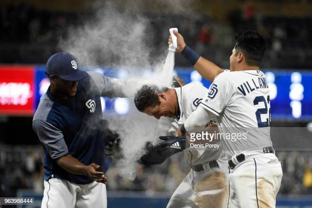 Hunter Renfroe of the San Diego Padres is doused with powder by Franchy Cordero left and Christian Villanueva after hitting a game winning single...