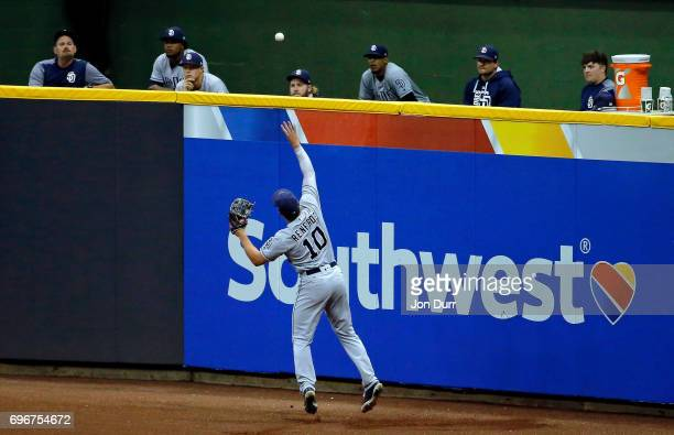 Hunter Renfroe of the San Diego Padres is unable to play the ball off the wall on a double hit by Eric Thames of the Milwaukee Brewers during the...