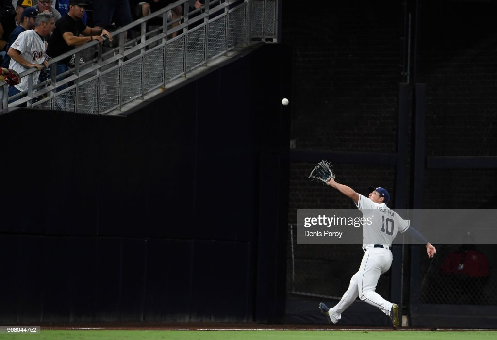 Hunter Renfroe #10 of the San Diego Padres makes a running catch on a foul ball hit by Ender Inciarte #11 of the Atlanta Braves during the sixth inning of a baseball game at PETCO Park on June 5, 2018 in San Diego, California.