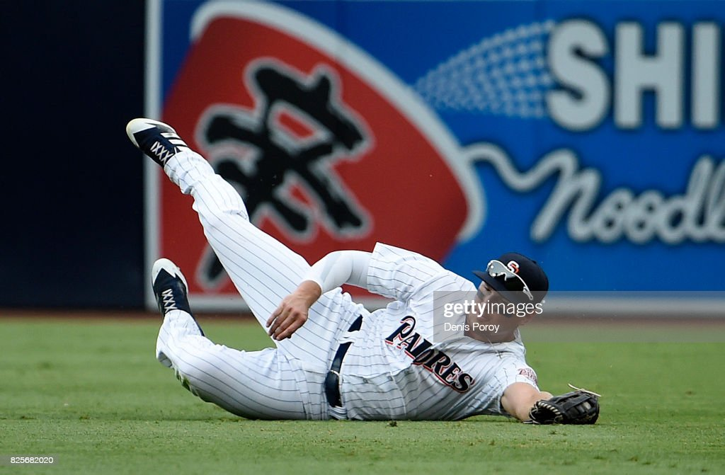 Hunter Renfroe #10 of the San Diego Padres makes diving catch on a ball hit by Miguel Sano #22 of the Minnesota Twins during the eighth inning of a baseball game at PETCO Park on August 2, 2017 in San Diego, California.