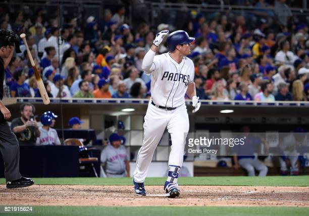 Hunter Renfroe of the San Diego Padres tosses his bat after hitting a solo home run during the seventh inning of a baseball game against the New York...