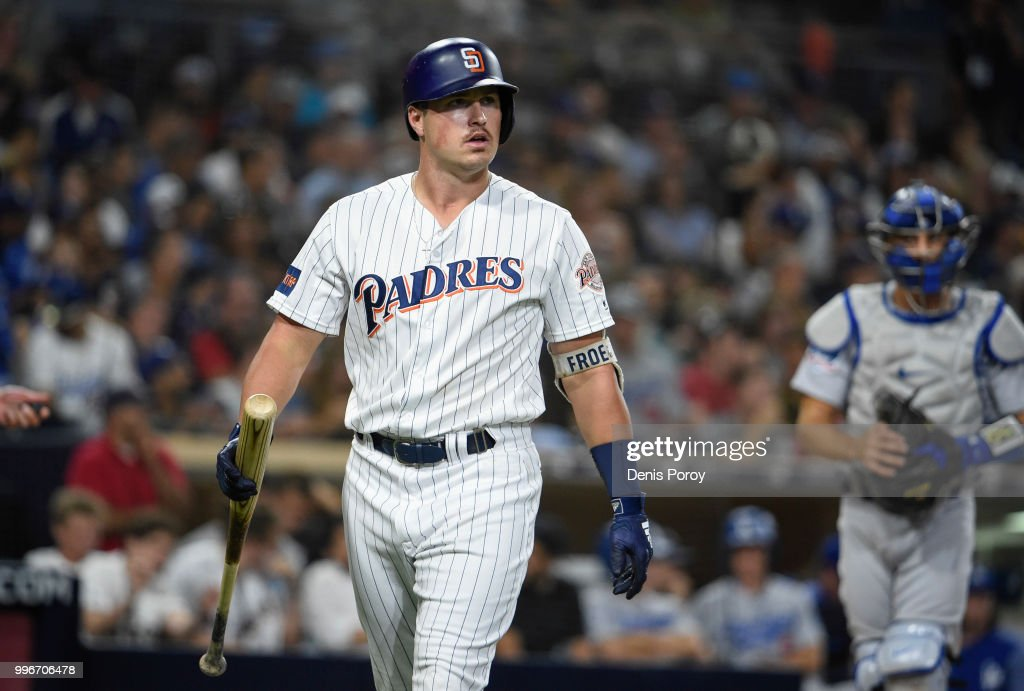 Hunter Renfroe #10 of the San Diego Padres walks back to the dugout after striking out during the fiourth inning of a baseball game against the Los Angeles Dodgers at PETCO Park on July 11, 2018 in San Diego, California.