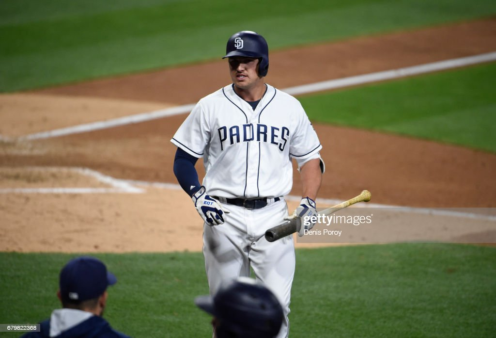 Hunter Renfroe #10 of the San Diego Padres walks to the dugout after striking out during the eighth inning of a baseball game against the Los Angeles Dodgers at PETCO Park on May 6, 2017 in San Diego, California.
