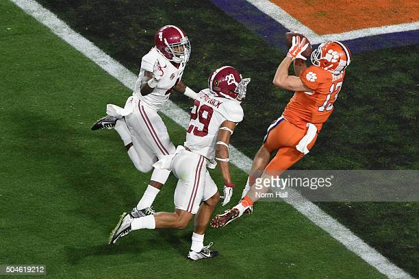 Hunter Renfrow of the Clemson Tigers catches a 31 yard touchdown pass from Deshaun Watson in the first quarter against the Alabama Crimson Tide...