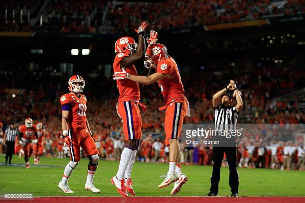 Hunter Renfrow of the Clemson Tigers celebrates with Trevion Thompson after scoring a touchdown in the third quarter against the Oklahoma Sooners...
