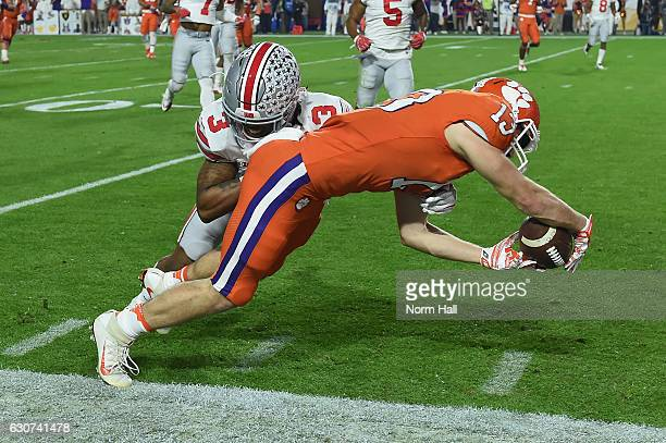 Hunter Renfrow of the Clemson Tigers is hit by Damon Arnette of the Ohio State Buckeyes during the first half of the 2016 PlayStation Fiesta Bowl at...