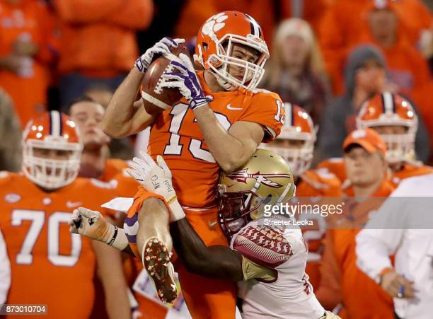 Hunter Renfrow of the Clemson Tigers makes a catch over AJ Westbrook of the Florida State Seminoles during their game at Memorial Stadium on November...