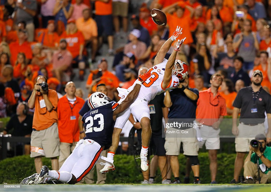 Hunter Renfrow #13 of the Clemson Tigers scores a touchdown during the fourth quarter against Johnathan Ford #23 of the Auburn Tigers at Jordan Hare Stadium on September 3, 2016 in Auburn, Alabama.