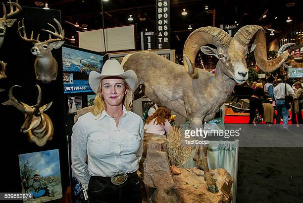 Hunter Roxanne Kelso with her taxidermied Desert Bighorn Sheep The Safari Hunters Club convention 2004 held in Reno Nevada The annual event features...