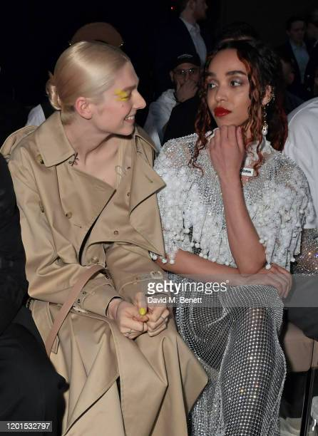 Hunter Schafer and FKA Twigs attend the Burberry Autumn/Winter 2020 show during London Fashion Week at Kensington Olympia on February 17 2020 in...