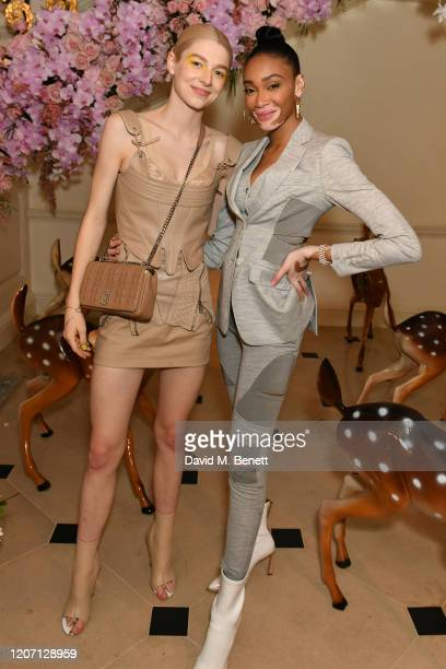 Hunter Schafer and Winnie Harlow attend the Burberry Autumn/Winter 2020 show after party hosted by Riccardo Tisci on February 17 2020 in London...