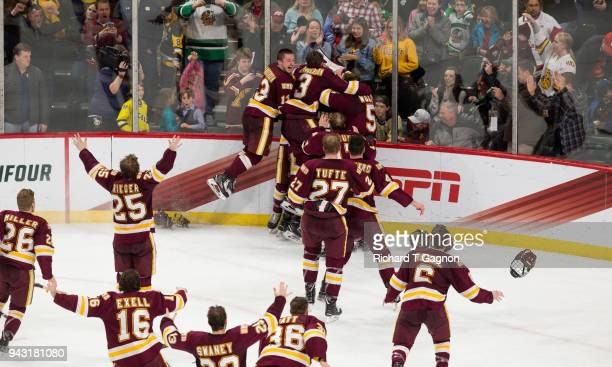Hunter Shepard of the Minnesota Duluth Bulldogs celebrates with his teammates after the Bulldogs won the national championship against the Notre Dame...