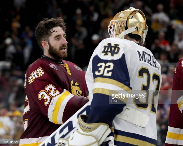 Hunter Shepard of the MinnesotaDuluth Bulldogs and Cale Morris of the Notre Dame Fighting Irish shake hands after the championship game of the 2018...