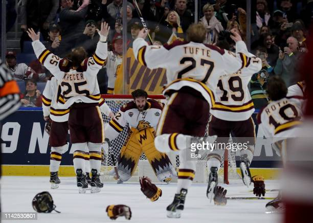 Hunter Shepard of the Minnesota-Duluth Bulldogs and the rest of his teammates celebrate the win over the Massachusetts Minutemen during the 2019 NCAA...