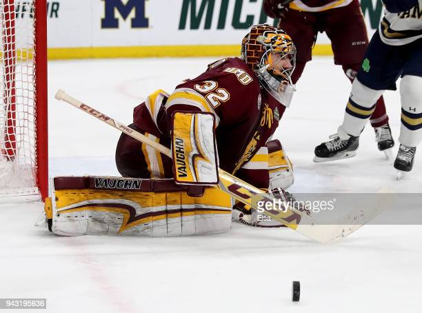 Hunter Shepard of the MinnesotaDuluth Bulldogs stops a shot by the Notre Dame Fighting Irish during the championship game of the 2018 NCAA Division I...