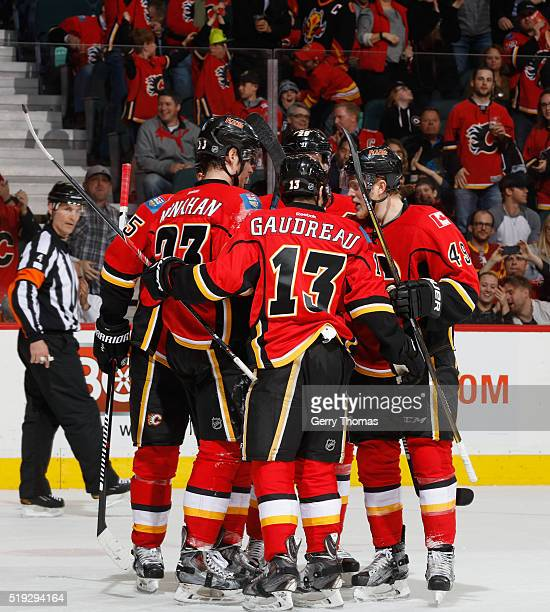Hunter Shinkaruk of the Calgary Flames celebrates with teammates after a goal against the Los Angeles King at Scotiabank Saddledome on April 5 2016...