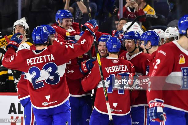 Hunter Shinkaruk of the Laval Rocket celebrates his game winning goal in a shootout with teammates against the Providence Bruins during the AHL game...