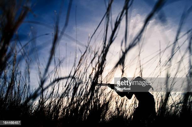 hunter sniper in bushes